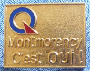Épinglette portant le logo du Parti québécois, pour la victoire du Oui dans le comté de Montmorency, lors de la campagne référendaire de 1995.