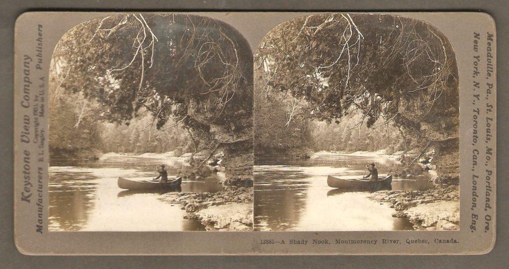 Un canotier solitaire dans un coin ombragé de la rivière Montmorency, un peu en aval de la chute. Il s'agit d'un stéréogramme de la Keystone View Company.